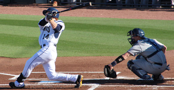 a batter swings at a pitch at one of the best colleges for baseball